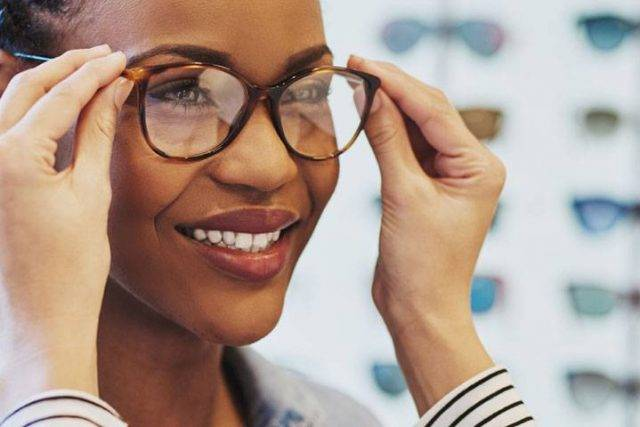 African Woman Trying on Glasses 1280x480 640x427